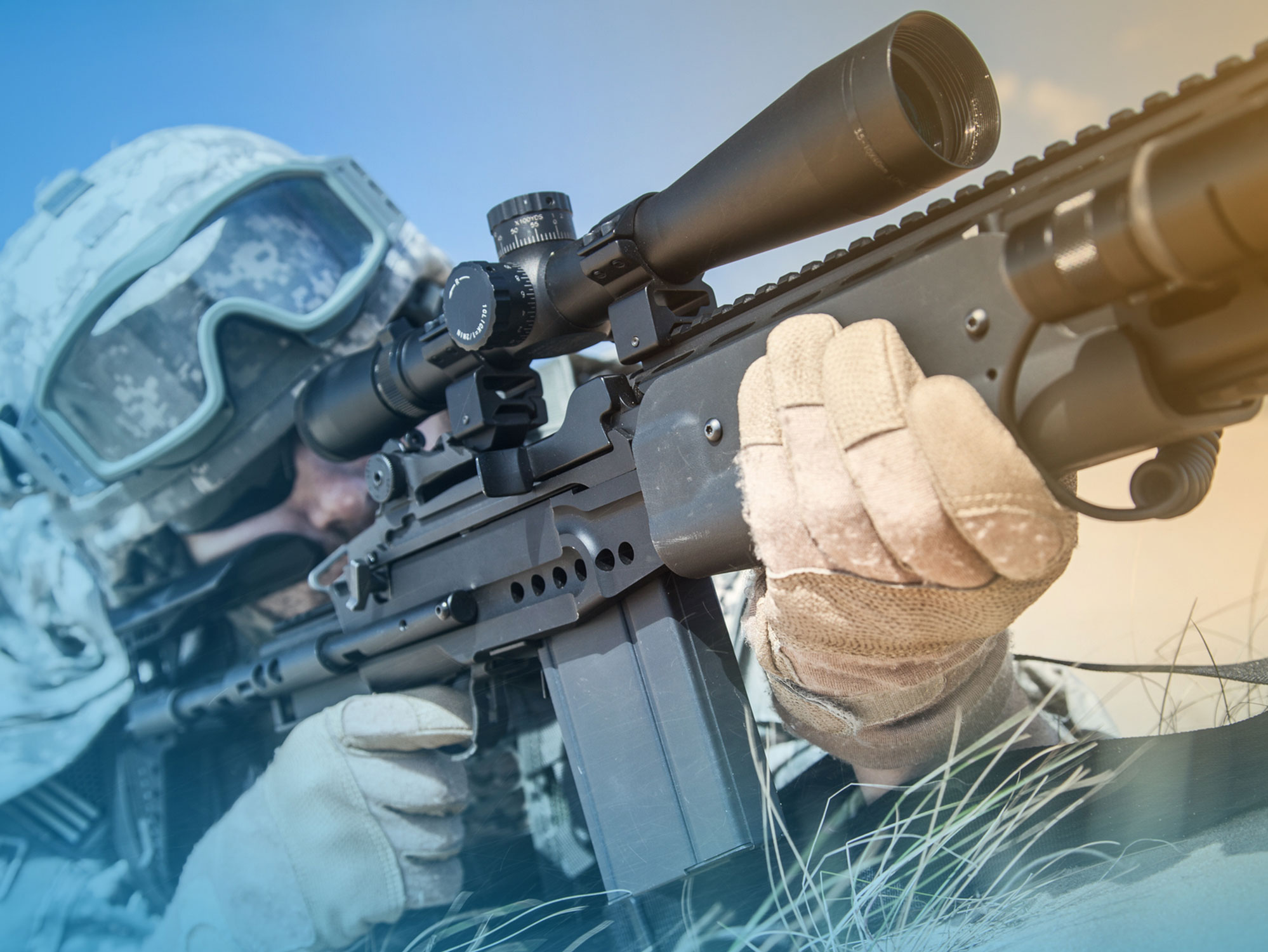 Military person aiming rifle